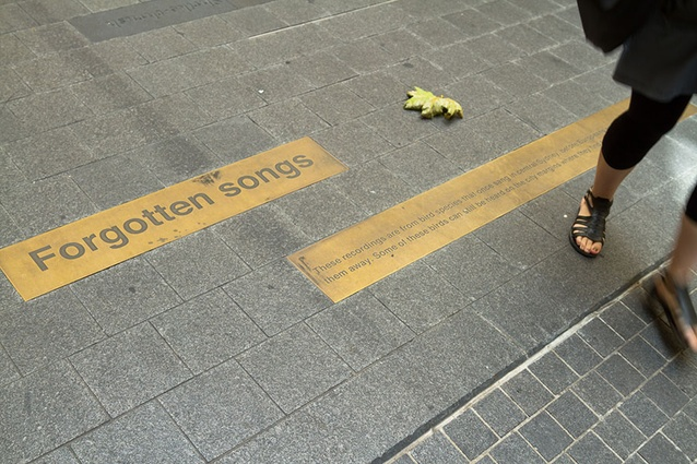 New footpath plaques in Angel Place commemorate the artwork overhead, <em>Forgotten Songs</em> by Michael Thomas Hill.