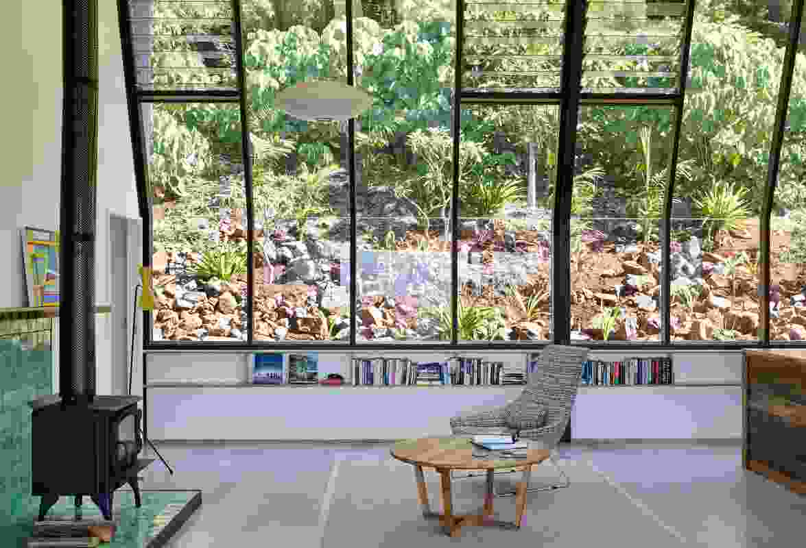 """A south-facing glass wall aligns with a hillside garden to create what the architect describes as a """"living painting."""""""