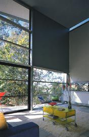 The double-height living space and panelled eastern wall.Image: Jon Linkins