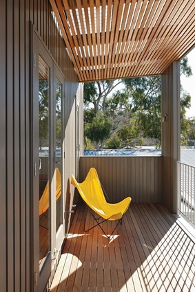 The studio balcony looks over treetop views of Canberra.