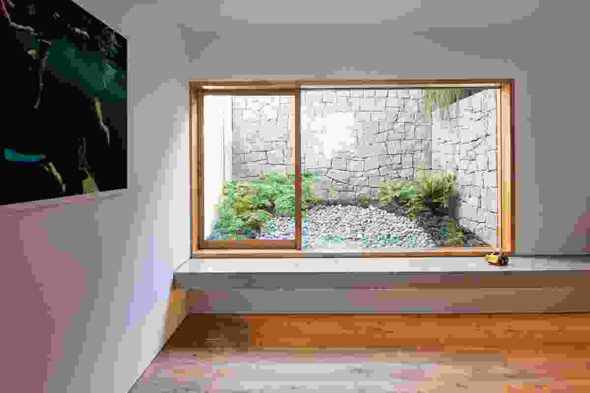 A window into a courtyard on the lower ground level acts as a light well.
