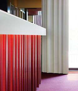 """Detail of the reception desk and door frame """"drapery"""", and the external """"curtain"""" beyond."""