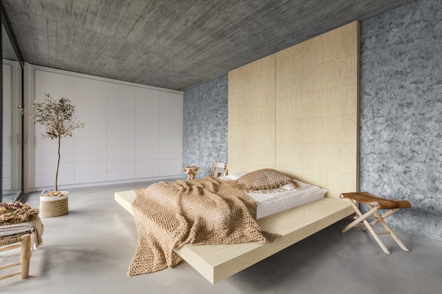 A bedroom featuring Essastone Luna Concrete by Laminex.