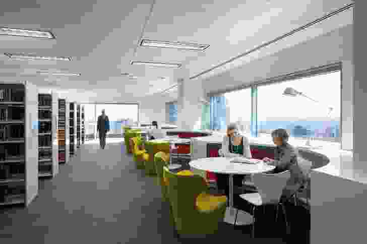 The library incorporates reading pods along the outside perimeter.