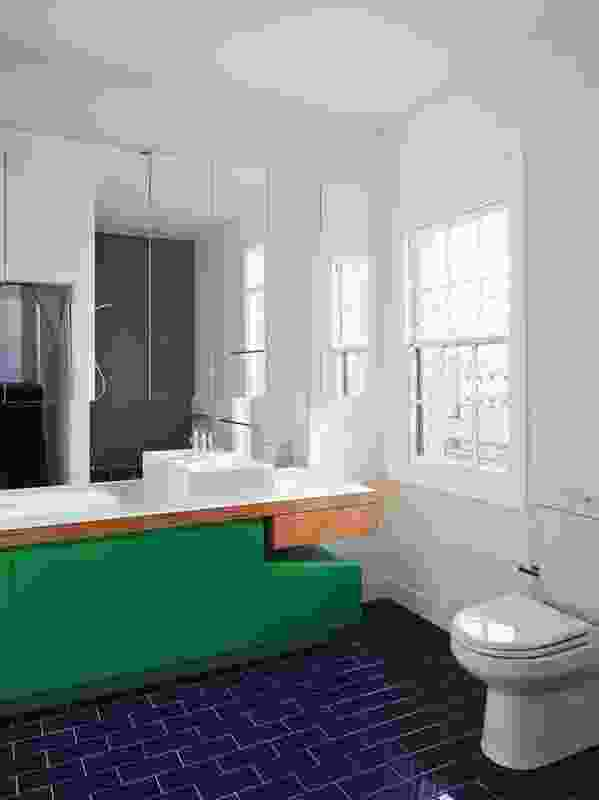 Bathroom renovations continue the theme of vibrant colour, white walls and playful shapes.