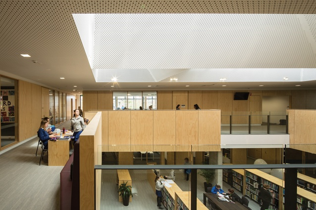 "The sky-lit double-height library is ""open and porous,"" allowing for interaction with adjoining learning spaces."
