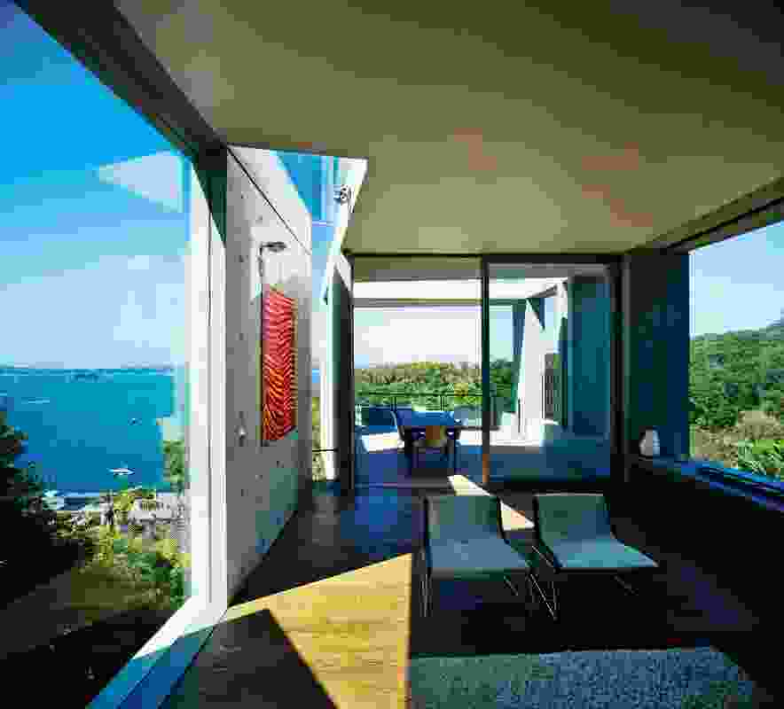 The living room tapers towards the dramatic cantilevered deck.
