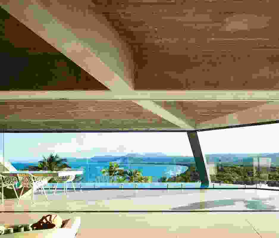 From the dining space at the east to the main bedroom at the west, the house has a view over Four Mile Beach to the horizon.