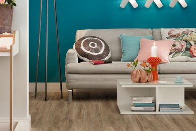 A living room featuring Dappled Oak flooring from the Affinity Range.