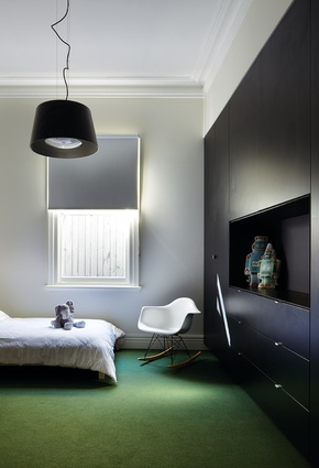 The bedrooms are fitted with new joinery finished in a sleek black.