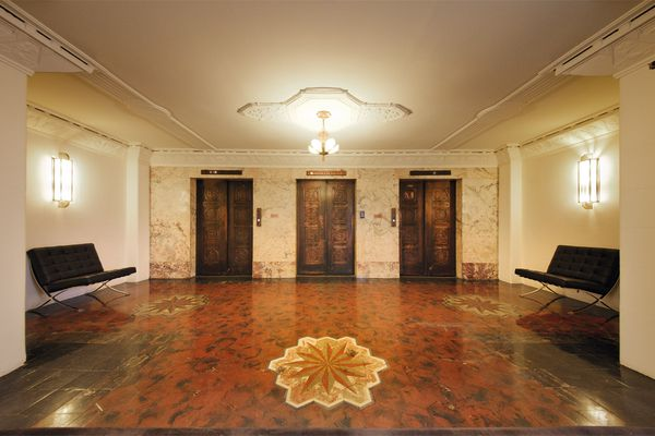 The level-11 lobby with original marble inlay flooring.
