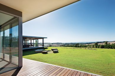 Floor-to-ceiling glazing captures the expansive views.