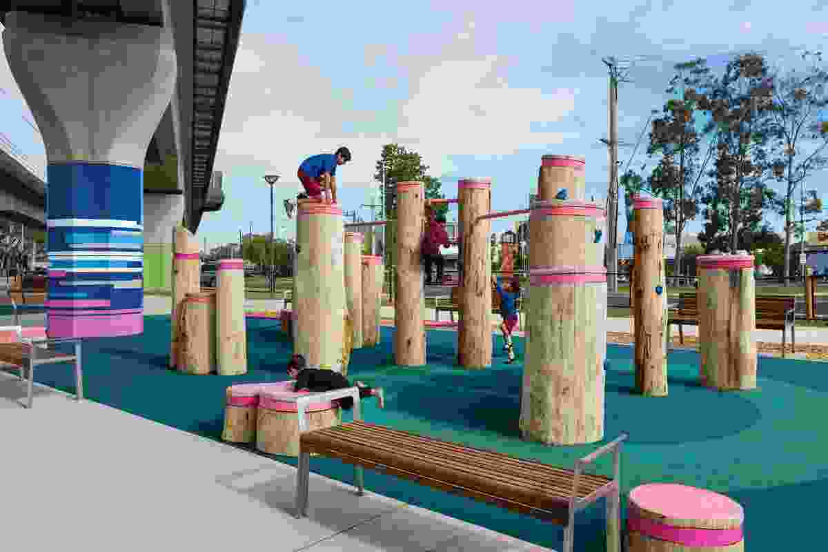 At Noble Park station, a parkour course built from unsawn logs dare local residents to clamber on top.