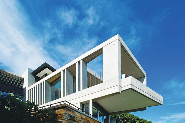 The dramatic cantilever hangs out over a swimming pool.