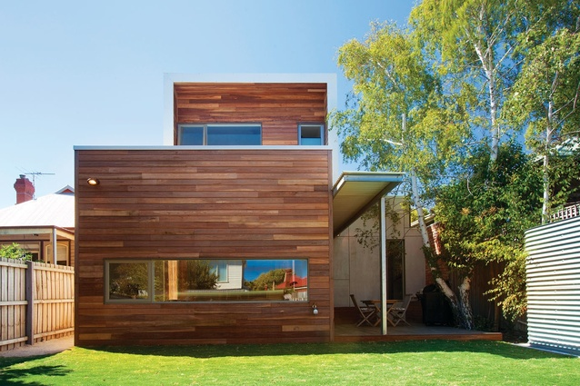 Ironbark timber and fibre cement sheeting add warmth to the facade.