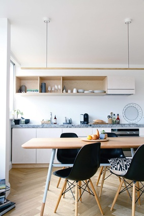Ashfield Apartment by Archier featuring Archier's Highline pendant light and Otway dining table.
