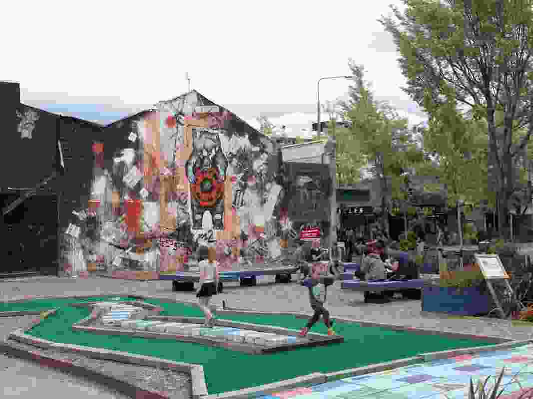 """Riccarton and Rotheram Corner: Hope Bear, a mural, by artist Tess Sheerin is a focal point for this corner site that was created """"to help brighten up the city and inspire other people in Christchurch to make their mark""""."""