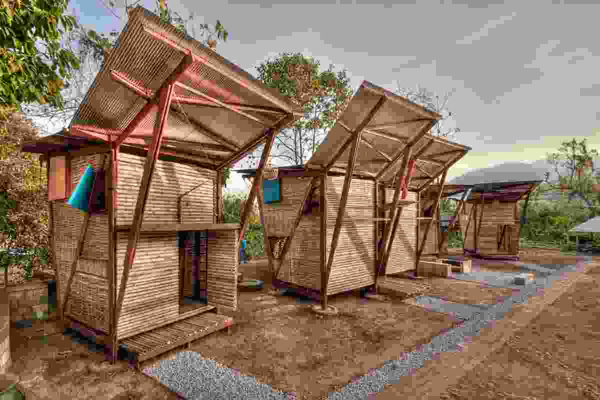 TYIN tegnestue Architects, Tie House: the area in front of the houses is defined by a drained pathway.