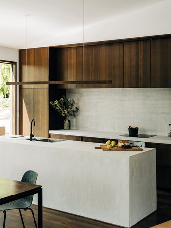 Concrete has been used as a contrasting, cost-effective and hardwearing material for the kitchen bench.