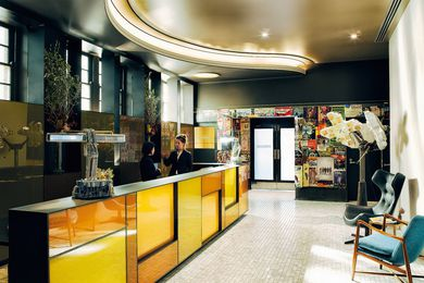Once a pokies room, the reception area features a reception desk made from illuminated amber-coloured panes of glass.