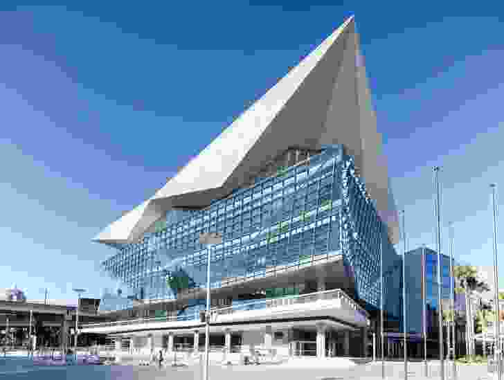 The angular, glazed form of the ICC Sydney Convention Centre is divided from the remainder of the ICC complex by the Western Distributor expressway.