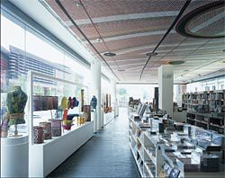 Interior of the bookshop, with  Mardayin at Milmilngkan, 2006, by John Mawurndjul on the ceiling. Image: Philippe Ruault