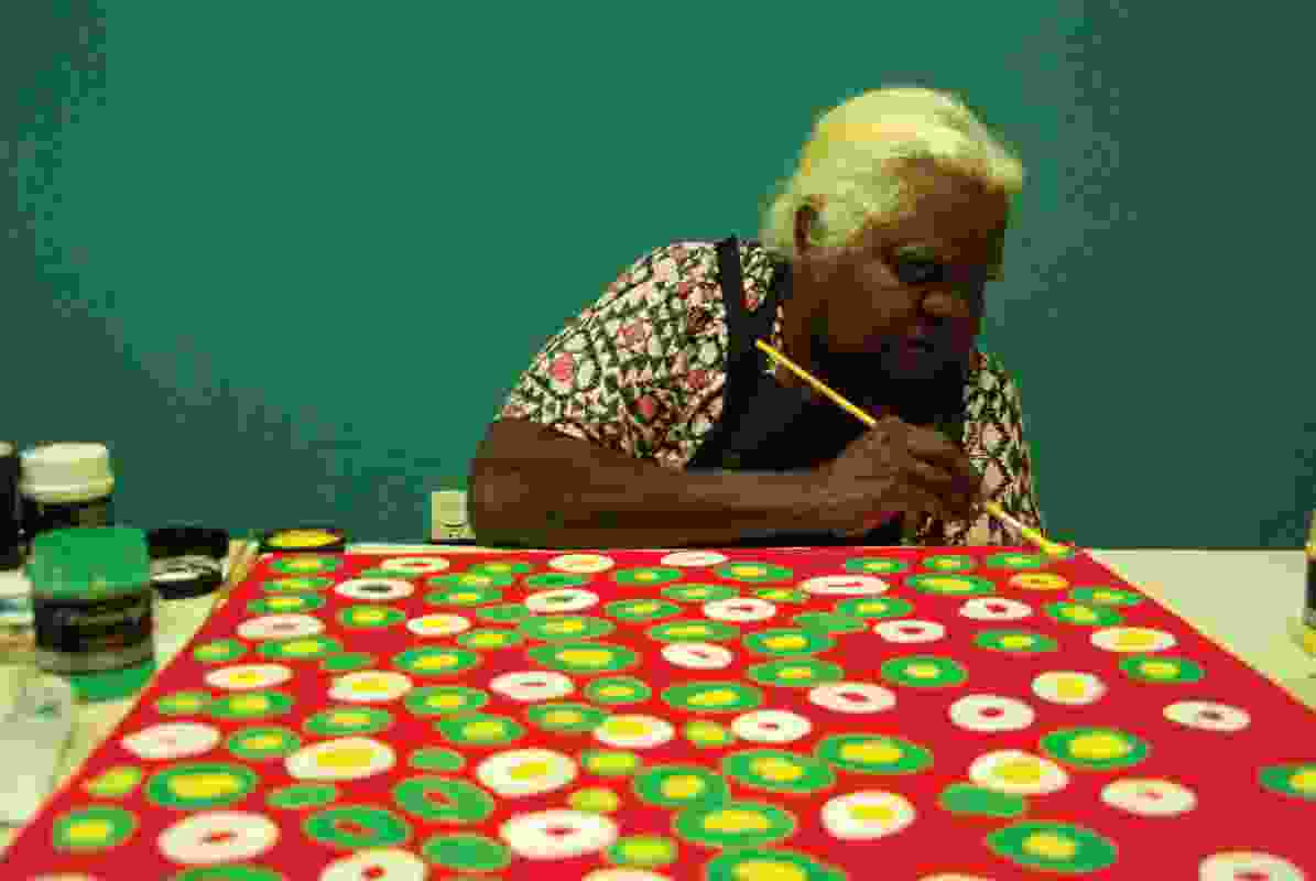 Susie Gilbert working on a painting to be converted into a shade structure at Liyan-ngan Nyirrwa (Cultural Healing Centre).