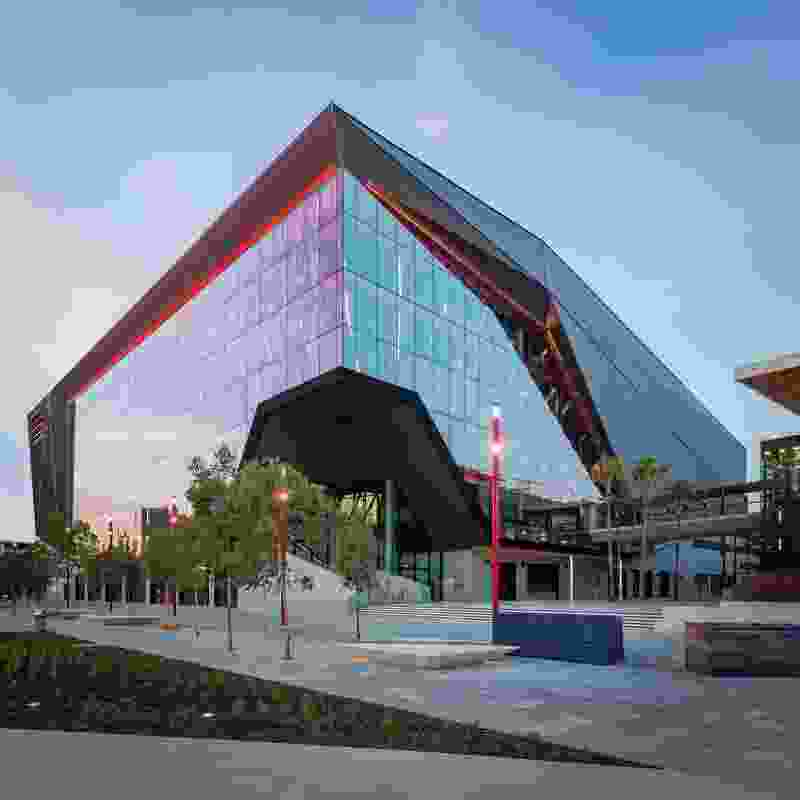 """Looking across Tumbalong Boulevard, the ICC Sydney Theatre is bold and assertive, its entry """"a maw clawed out of the otherwise closed form."""""""