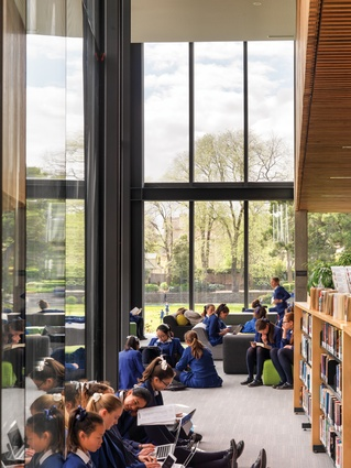 A reading space on the first floor of the north-west corner features extensive glazing, providing views to mature trees in St Michael's Green.