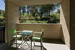 A private, semi-enclosed balcony space showing the framed view to Grey Gums Park beyond. Image: Graham Philip