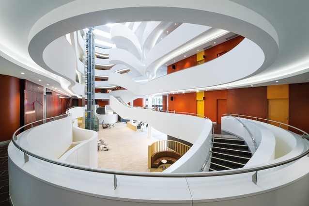 The grand six-storey atrium carves out a glowing white canyon in the centre of the building.