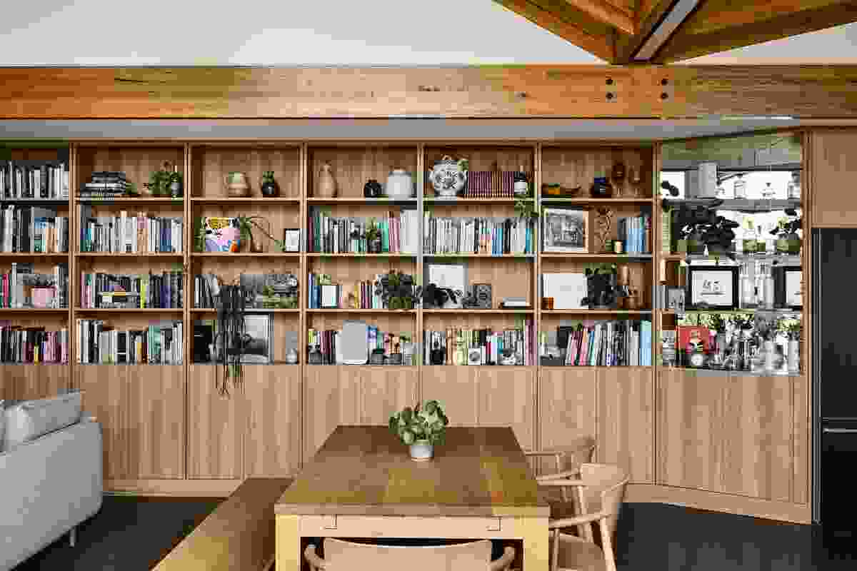 The southern spine of Garden House by BKK Architects is entirely shelves, displaying books and a collection of ceramics.
