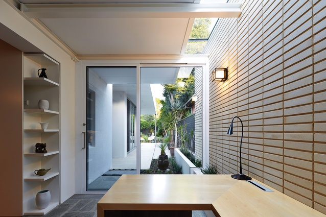 To embrace the adjacent courtyard, the neutral material palette extends the inside out (or vice versa) at House on Mayfair.