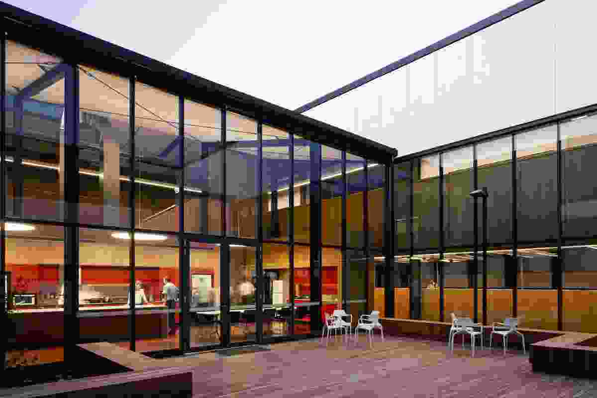 The central courtyard acts as a refuge for officers on duty and allows daylight into the interior.