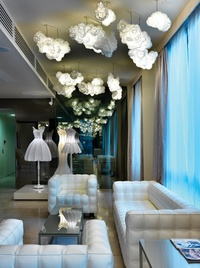 The Lobby With Cloud Like Lights And Lampshade Dresses. Image: Courtesy Of  Design Hotels