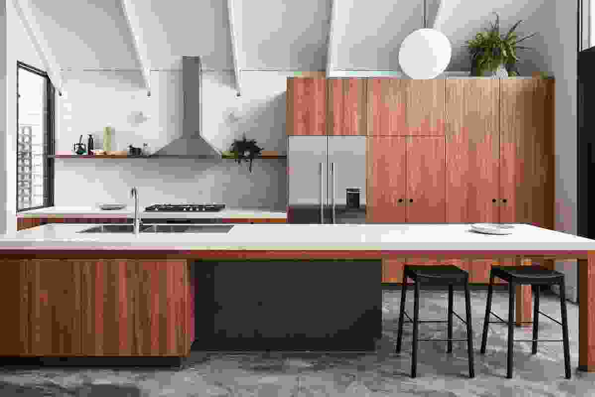 A kitchen island extends to become a bench for casual gatherings.