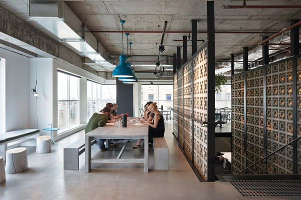 The L-shaped cafe and hub space encourages staff collaboration.