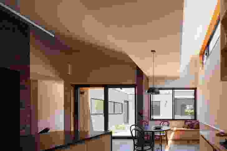 The roof profile allows for highlight windows oriented north that fill the interior with natural light.