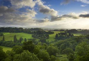 A view of the landscape park and countryside surrounding Newton House seen from the ruined medieval Dinefwr Castle.