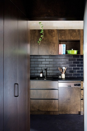 Blinco Street House features more elaborate finishes than earlier projects, such as glazed bricks in the splashback and Paperock benchtops.