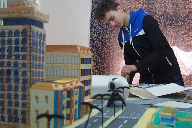 Mohammed Kteish at work creating his cityscape.
