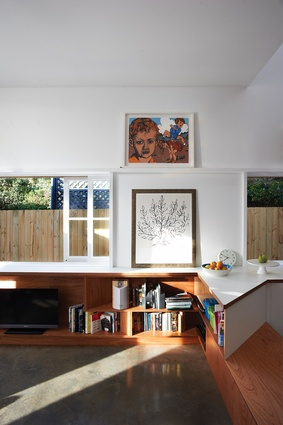 Living room detail, open to the side path. Art: David Bromley (top); Henry Matisse (bottom).