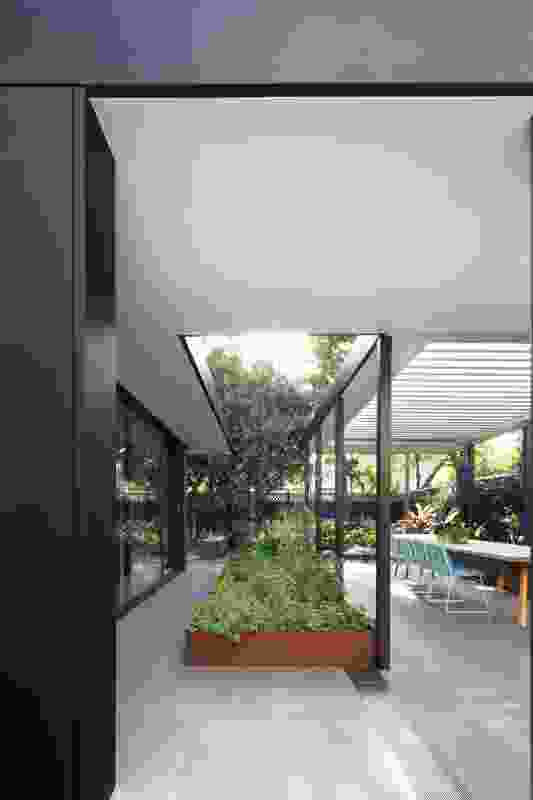 The external dining area is sheltered under a separate pavilion structure from the main living area.
