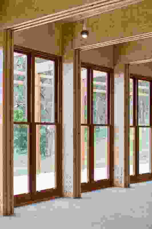 Double-hung windows of recycled blackbutt are fitted externally with heavy-duty stainless steel insect and ember screens.