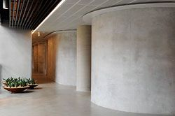 The curved concrete walls enclosing the meeting spaces on each level. Image: Marcus Clinton