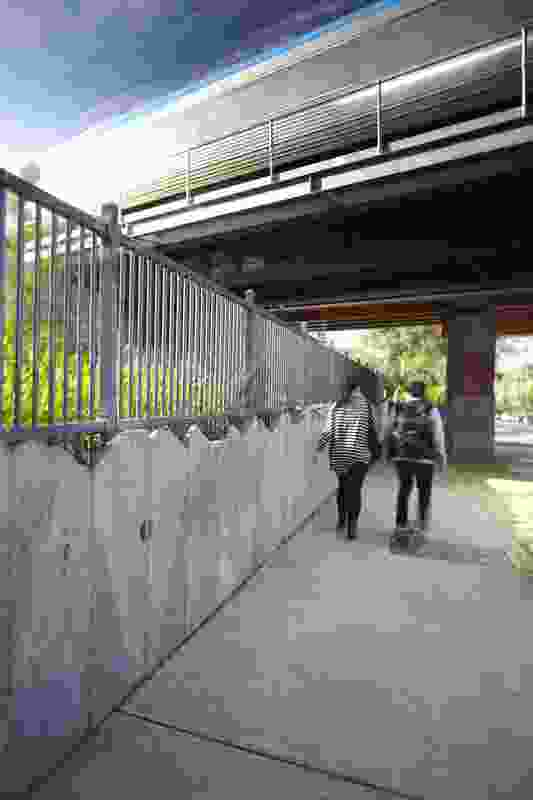Urquhart Street bridge underpass - Bluestone retaining walls and simple railing fence created an attractive solution to maintaining public safety by limiting access to rail tracks. This treatment blends well with the residential street context.  Bluestone was specified as Urquhart street is under a heritage overlay.