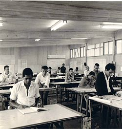 Oscar Niemeyer's studio at Brasilia, 1958. Reuben Lane is at the far left and Niemeyer is visible at the back of the studio, leaning over a drafting board. Courtesy Reuben Lane.