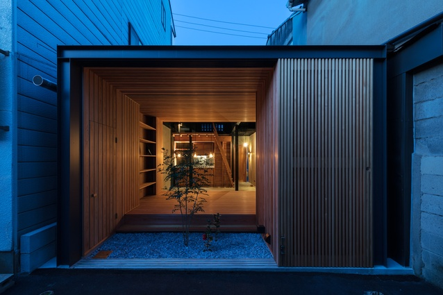 The rear facade of the Kyoto Terrace House by Atelier Luke is decidedly modern with its steel frame and timber screens.