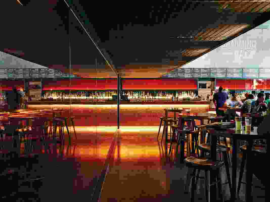 Amber-toned glass is used as feature walling to the keg room, and as lighting panel backdrops in the bar areas.