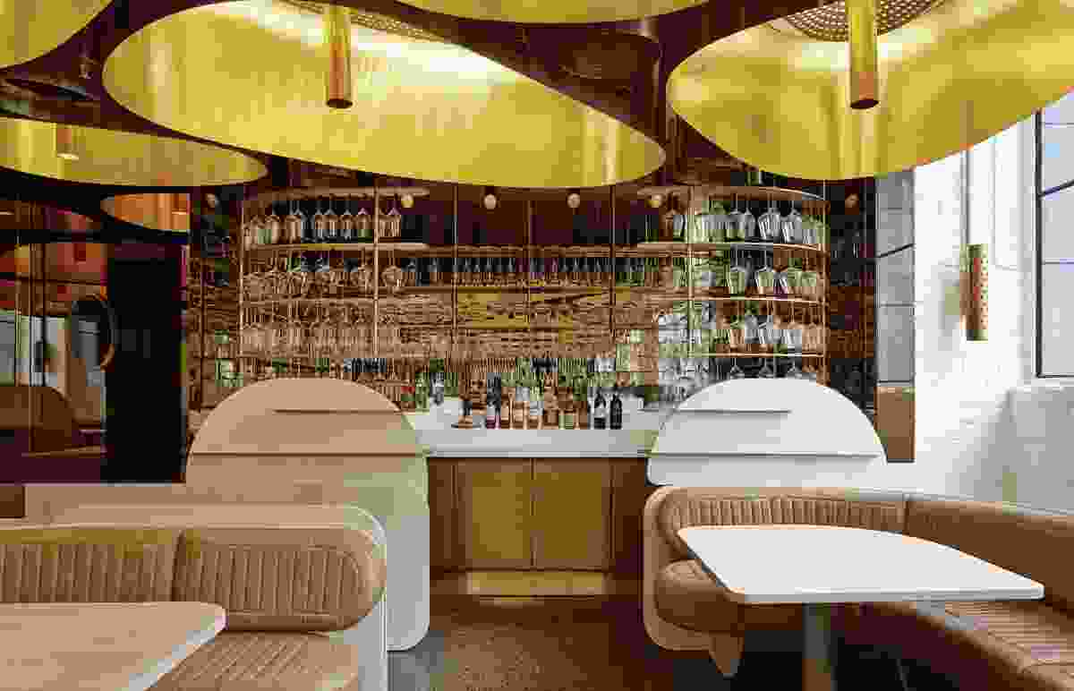 The bar is a slick and glowing feature of the restaurant.
